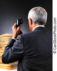 Mature Businessman With a Pile of Work