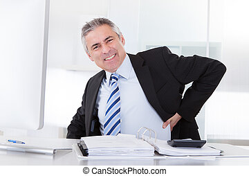 Mature Businessman With Back Pain