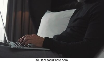 Mature businessman with laptop in a hotel room. -...