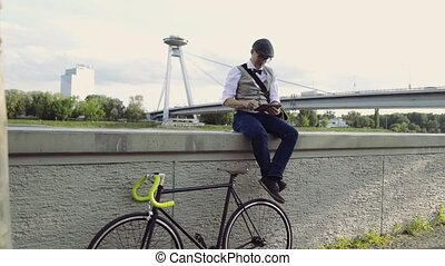 Mature businessman with tablet and bicycle at the river. -...