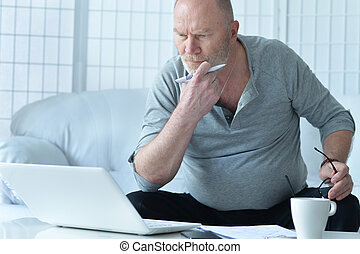 mature businessman working at home