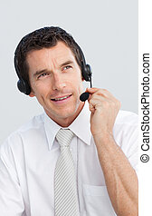 Mature businessman working in a call center