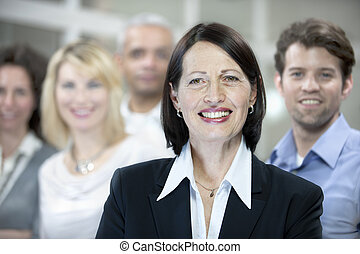 mature businesswoman and business team
