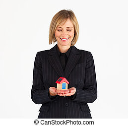 Mature businesswoman dreaming about a house