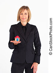 Mature businesswoman holding a house