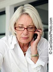 Mature businesswoman making telephone call