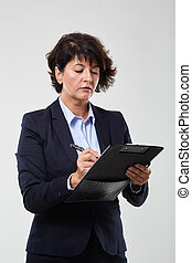 Mature businesswoman with a clipboard