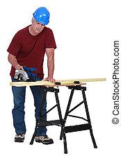 mature carpenter at work
