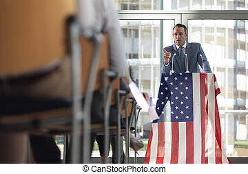 Mature Caucasian businessman speaking in conference room during meeting