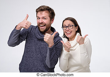 Mature caucasian couple man and woman showing thumbs up