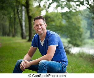 Mature caucasian man smiling outdoors - Portrait of a mature...