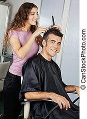 Mature Client Getting Haircut In Salon