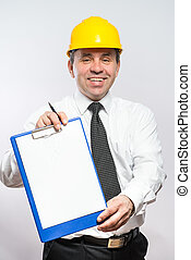 Mature contractor with hardhat and clipboard
