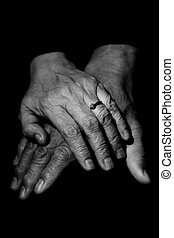 Mature couple - A couple of mature couple holding hands in...