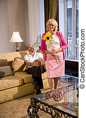 Mature couple at home in living room