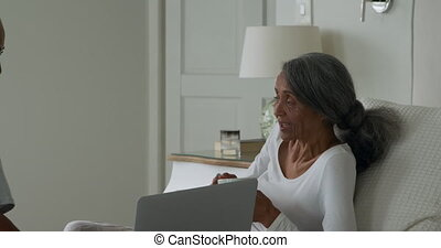 Mature couple at home - Side view of a mature mixed race ...