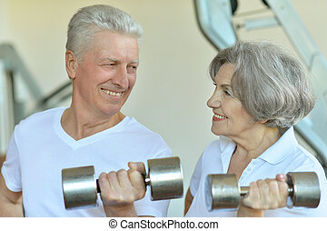 mature couple at the gym