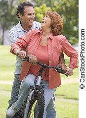 Mature couple bike riding.