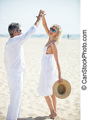 mature couple dancing on the beach happy and relax time