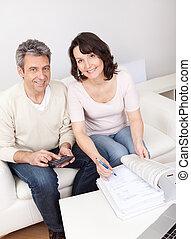 Mature couple doing family finances
