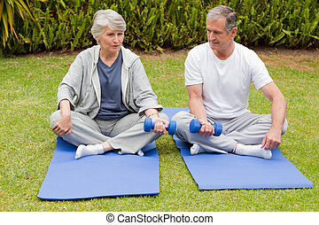 Mature couple doing their exercises