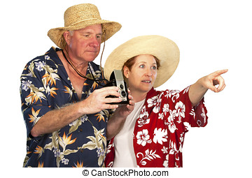 Mature couple dressed in hawaiian shirts with old time camera
