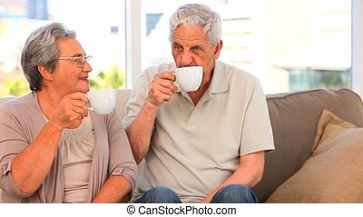 Mature couple drinking some tea