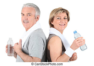 Mature couple drinking water