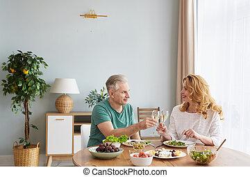 Mature Couple Enjoying Dinner at Home