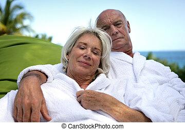 Mature couple enjoying spa weekend at the beach
