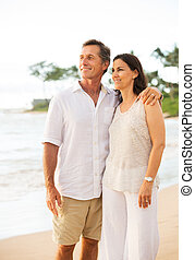 Mature Couple Enjoying Sunset on the Beach