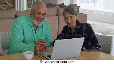 Mature couple enjoying time in her home