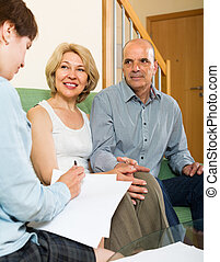 Mature couple filling questionnaire