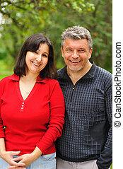 Happy mature couple outdoors portrait