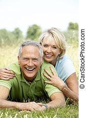 Mature couple having fun in countryside