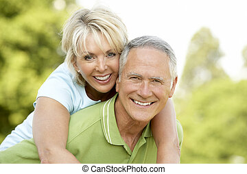 Mature couple having fun in countryside
