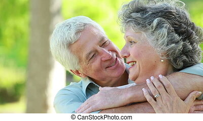 Mature couple hugging each other
