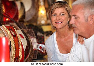 Mature couple in antique shop