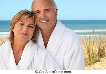 Mature couple in bathrobe