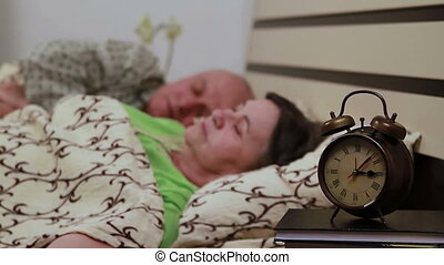 Mature couple in bed sleeping