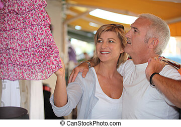 Mature couple in clothing store