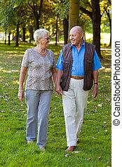 Mature couple in love is walking seniors.