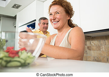 Mature couple in the kitchen - Close-up portrait of...