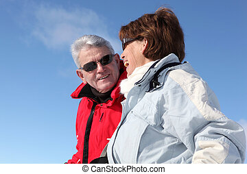 Mature couple in winter coats