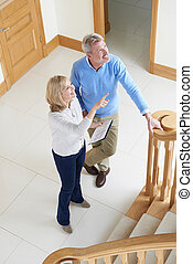 Mature Couple Looking Around House For Sale