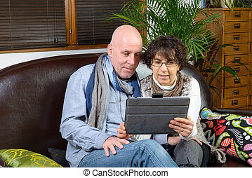mature couple looking at a digital tablet
