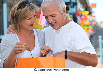 Mature couple looking at bag