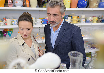 mature couple looking for kitchenware in store