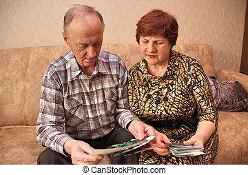Mature couple looking photos