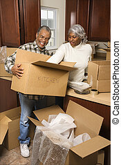 Mature couple moving.
